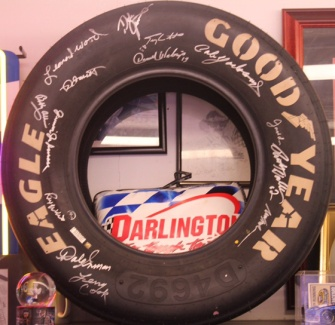 A tire from the 2016 Southern 500 autographed by all living Hall of Fame members
