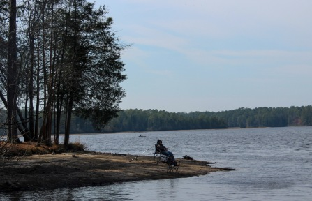 lake - fisherman and kayaker